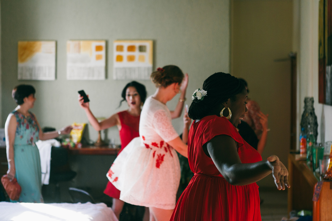 Mexican Filipino wedding Bridesmaids wearing red and white flowers lace